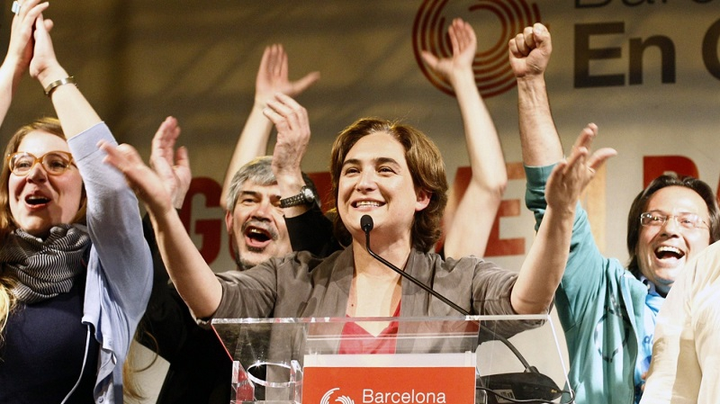 Ada Colau (center), leader of the Barcelona en Comúparty, celebrates in Barcelona during a press conference following the results in Spain's municipal and regional elections on May 24. She is the first member of Spain's indignados protest movement to win public offic
